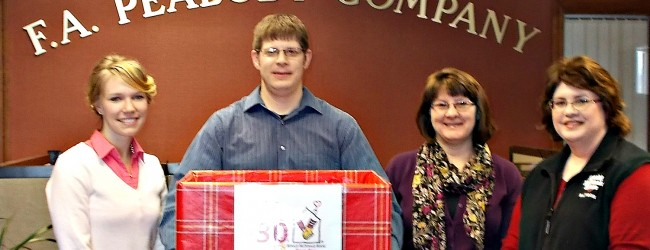 Chelsea Henderson, Ben Lynds and Mary Jane Cleary present donations to Ronald McDonald House of Bangor's Darlene MacLeod (right)