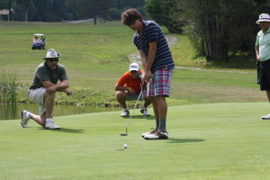 Our company president, Chris Anderson, watches his son, Lucas, play in the 2012 tournament.